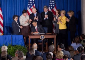 President Barack Obama signs a presidential memorandum at the America's Great Outdoors Conference at the Department of the Interior in Washington, D.C. April 16, 2010. (Official White House Photo by Samantha Appleton)